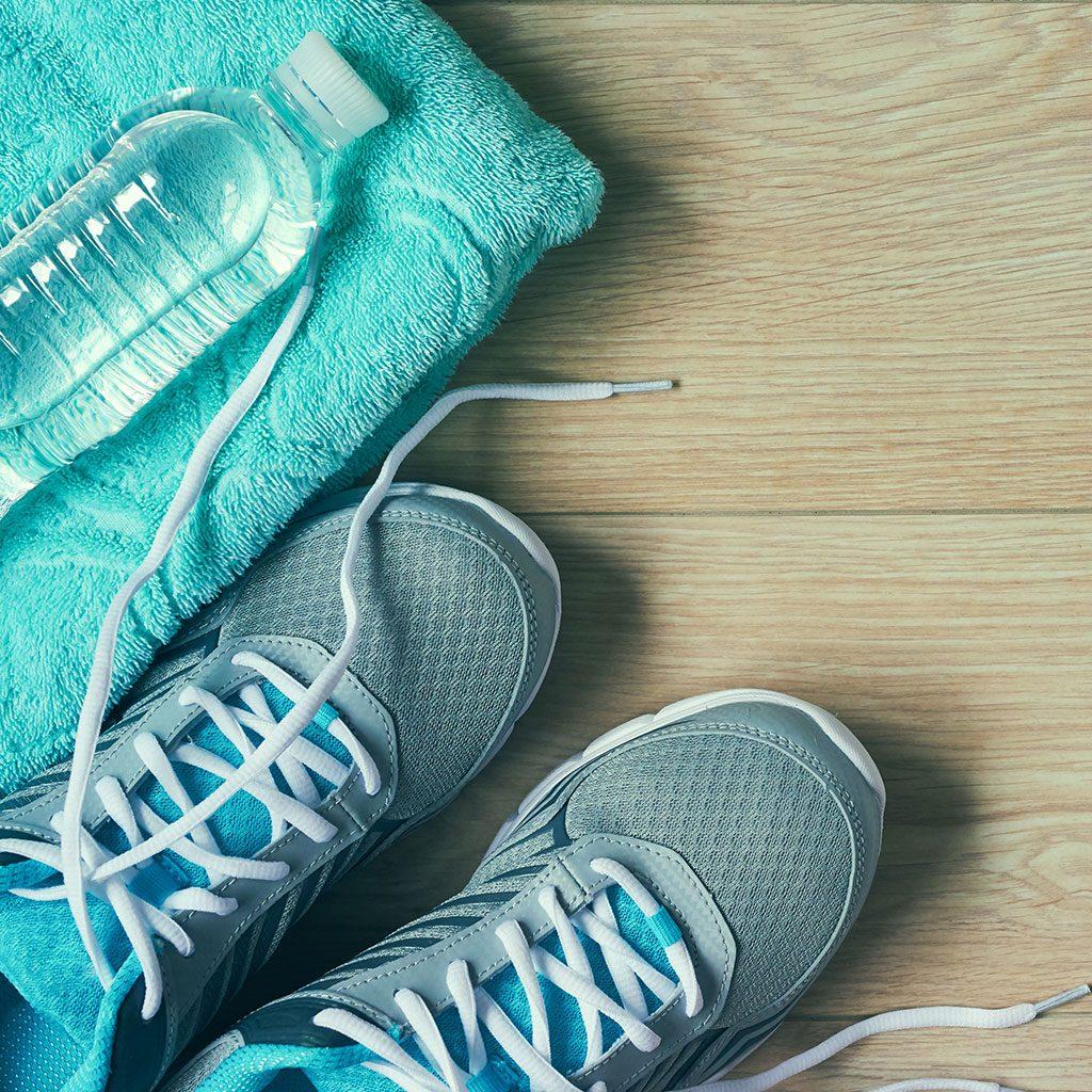 trainers bottle towel wooden floor